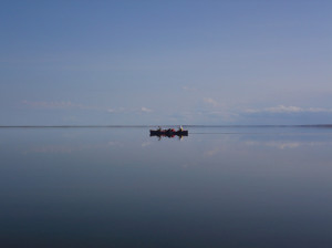 A canoe rests on the calm, Gary Lakes