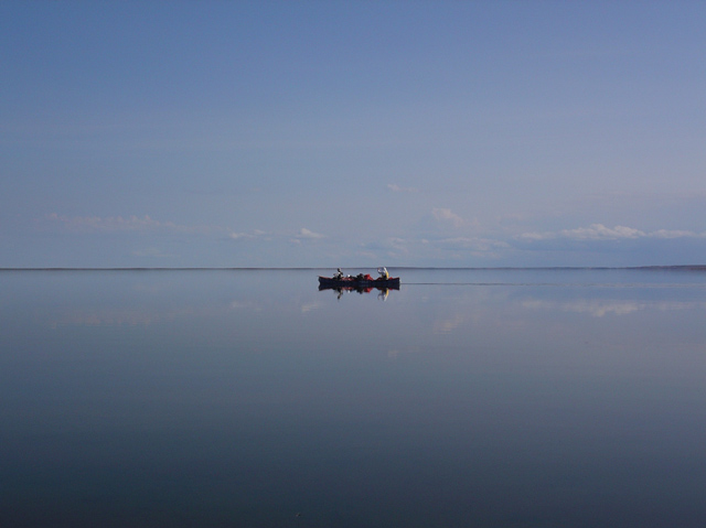 A canoe rests on the calm, Garry Lakes