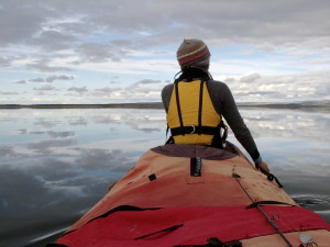Jennifer kingsley paddles in the bow of her canoe