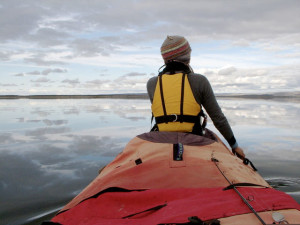 Jennifer Kingsley bow paddling on the Back river.
