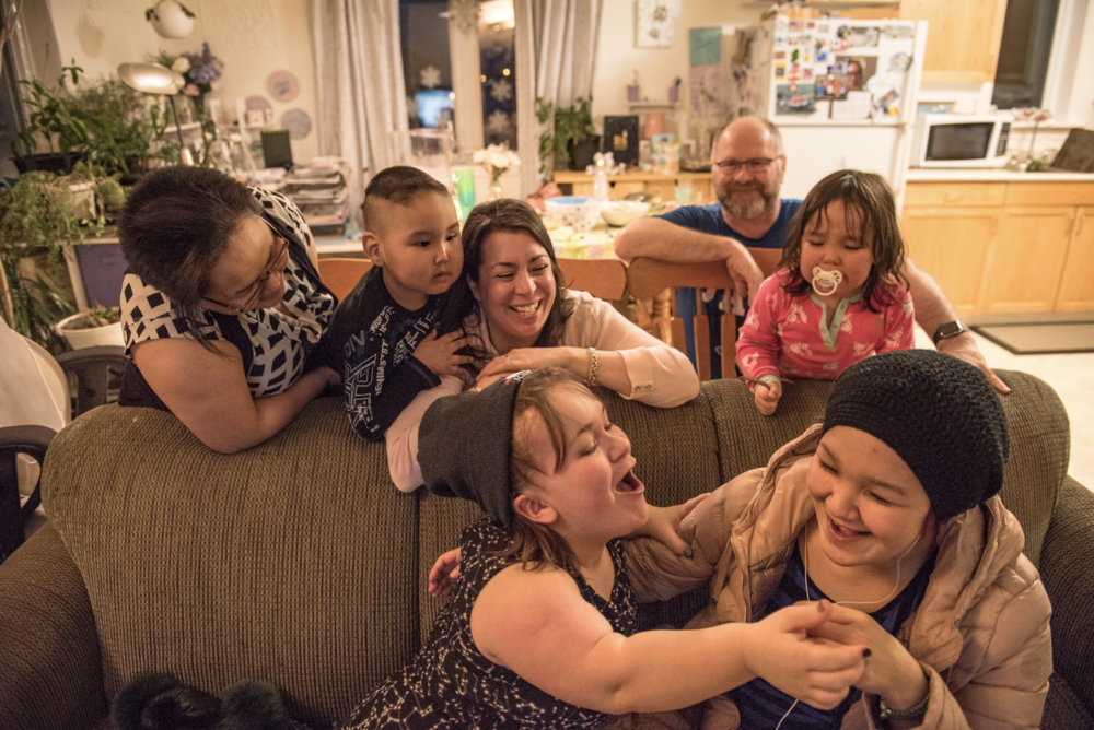 The Elverum family together in the living room