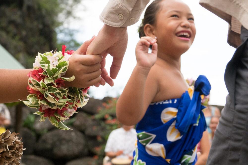 A little girl dances during a celebration.