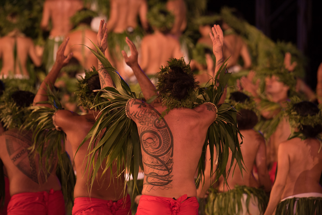 Local men participate in a ceremony where their traditional tattoos are on display.