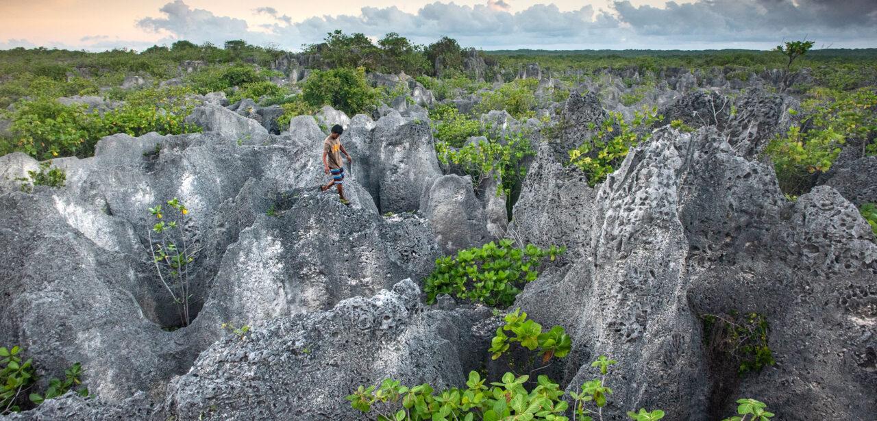 A man walks across a rocky landscape